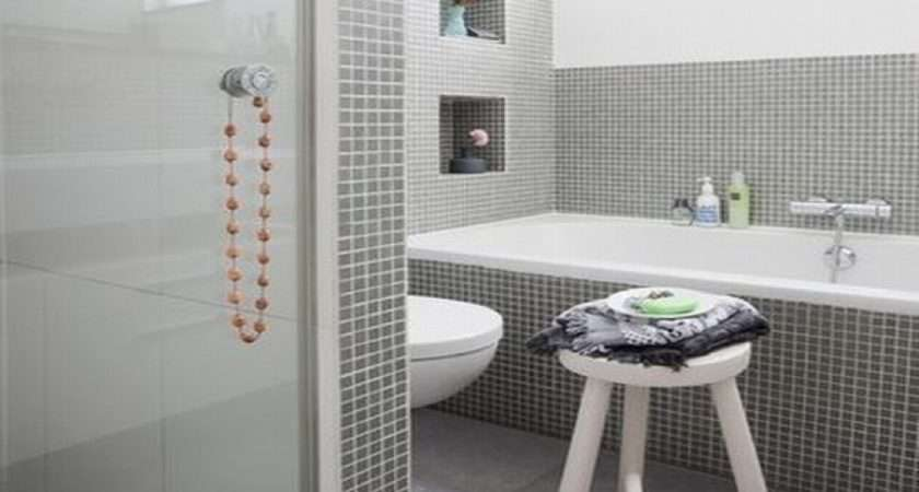 Awesome Small Space Grey Bathroom Added Oval White Tub Also Wall Tile