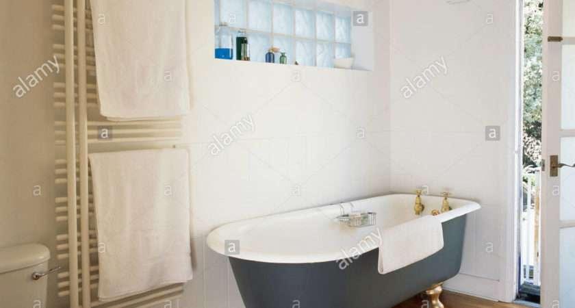 Black Roll Top Bath Wooden Flooring Modern White