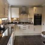 Burford Gloss Cream Kitchen Units Cairngorm Black Worktops