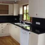 Cream Kitchen Black Tops Ark Property Services Ltd