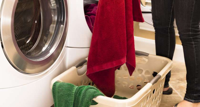 Domestic Life Woman Removing Towels Clothes Dryer Laundry