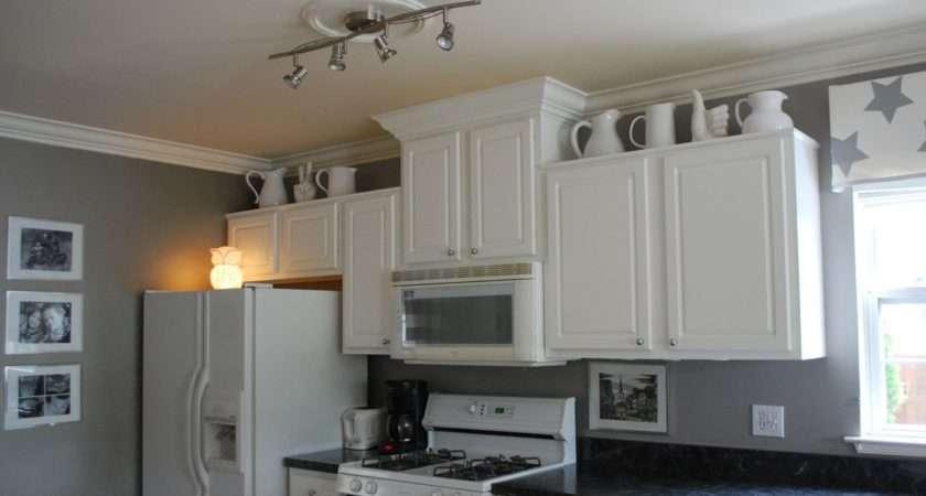 Minimalist Kitchen White Cabinets Beside Grey Walls