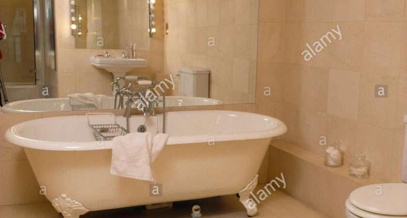 Mirrored Wall Behind Roll Top Bath Modern Bathroom
