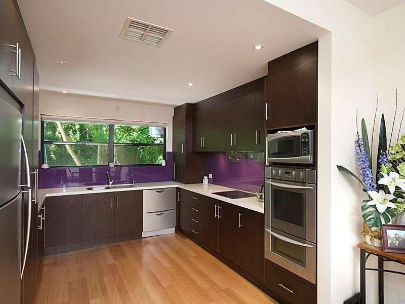 Modern Shaped Kitchen Design Using Floorboards