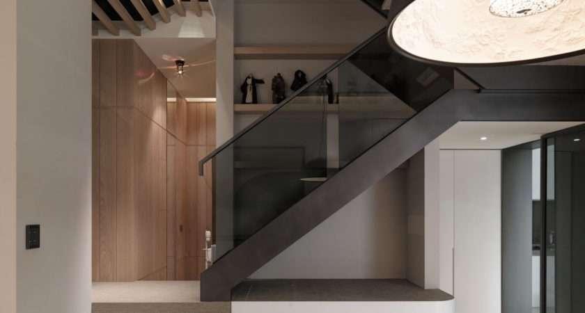 Staircase Boasts Smoky Glass Railing Framed Steel