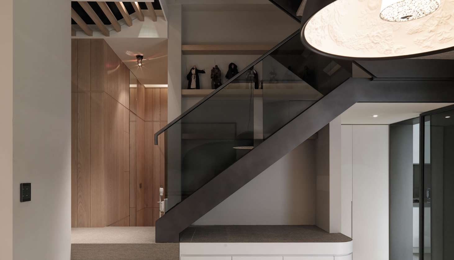Staircase Boasts Smoky Glass Railing Framed Steel