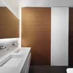 Victor Vasilev Wooden Wall Paneling Among White Bathroom