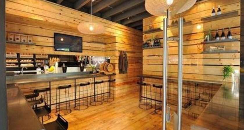 Wooden Paneling Wall Black Metal Bar Stools Warm